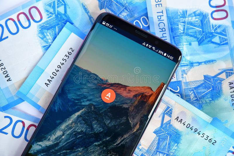 Moscow, Russia - July 23. 2018. phone with mobile application Alfa-Bank online and money stock photos