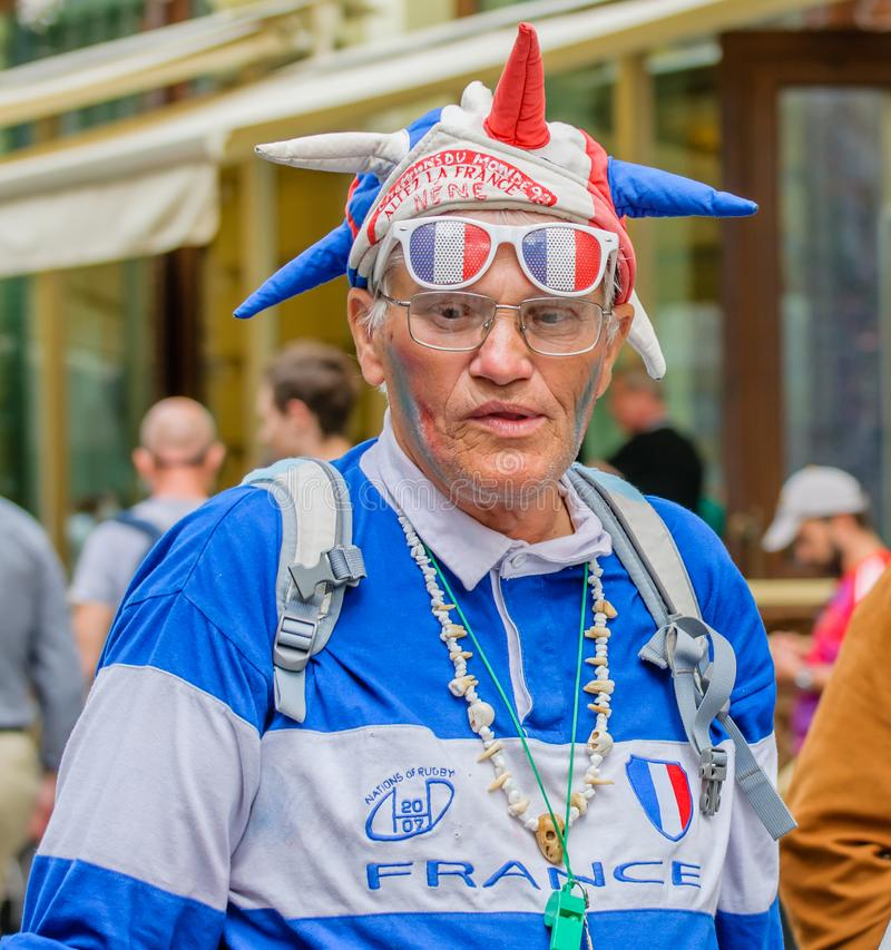 Moscow, Russia - July 7, 2018: Portrait of elderly French fan with football attribute in blue-white-red tricolor, flag stock image