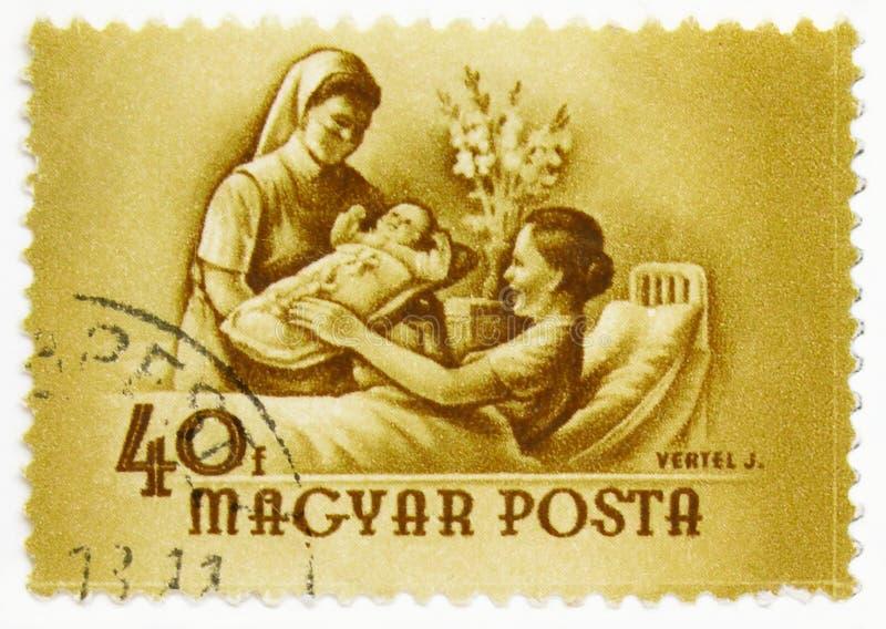 Mother receiving newborn baby, serie, circa 1954 royalty free stock photo