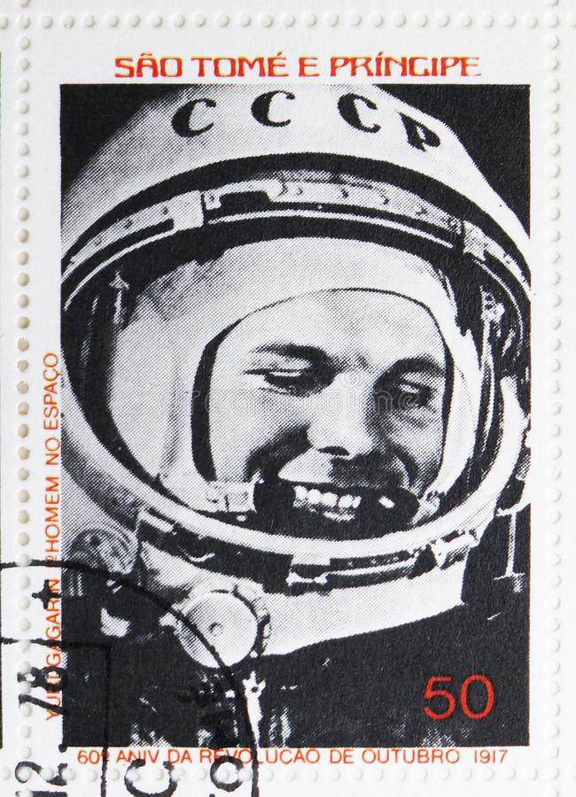 Juri Gagarin, 60th anniversary of the October Revolution serie, circa 1977. MOSCOW, RUSSIA - JULY 25, 2019: Postage stamp printed in Sao Tome and Principe shows royalty free stock photo