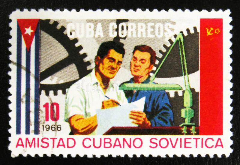 MOSCOW, RUSSIA - JULY 15, 2017: Rare stamp printed in Cuba shows. Engineers, Soviet-Cuban Friendship, circa 1966 royalty free stock images