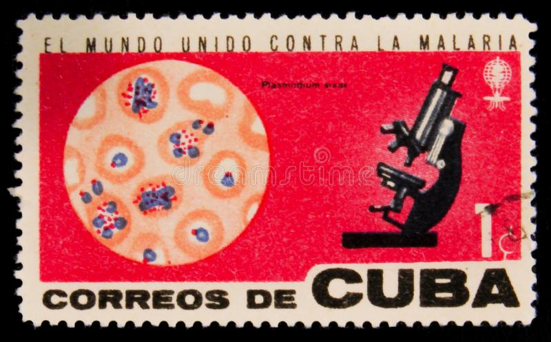 MOSCOW, RUSSIA - JULY 15, 2017: Rare stamp printed in Cuba shows. Microscope and molecules, Fight against Malaria, circa 1962 stock photography