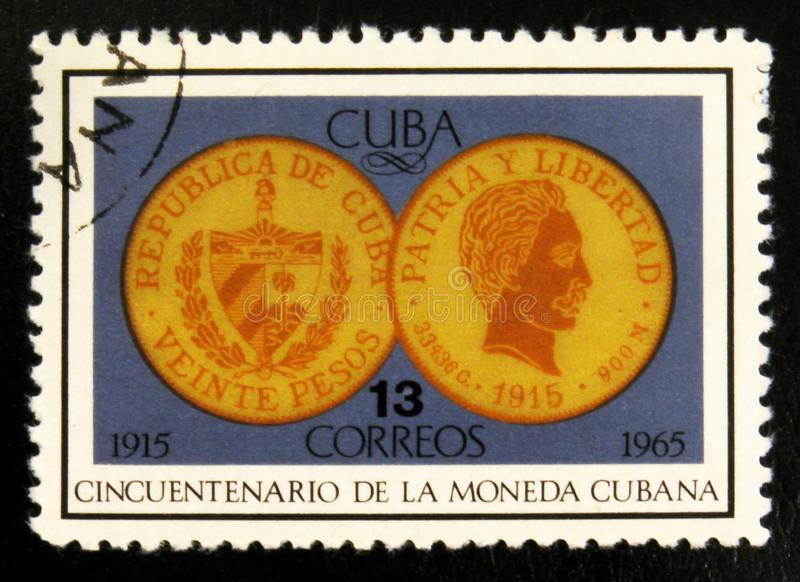 20 Pesos coin 1915, 50th Anniversary of Cuban liberty, circa 1965. MOSCOW, RUSSIA - JULY 15, 2017: Rare stamp printed in Cuba shows 20 Pesos coin 1915, 50th stock photography