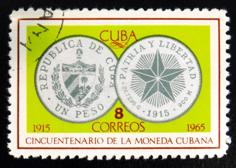 MOSCOW, RUSSIA - JULY 15, 2017: Rare stamp printed in Cuba shows. Silver coin one Peso, 1934, 50th Anniversary of Cuban currency, circa 1965 stock photos