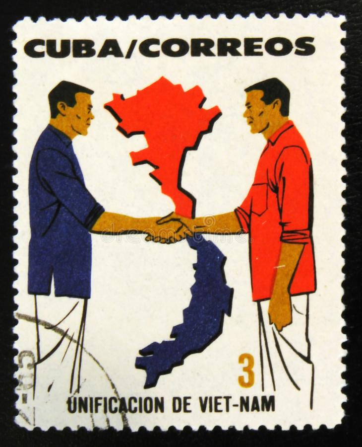 MOSCOW, RUSSIA - JULY 15, 2017: Rare stamp printed in Cuba shows. Two men handshake, Cuban-Vietnamese unification, circa 1964 stock photography
