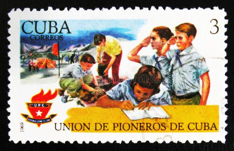 MOSCOW, RUSSIA - JULY 15, 2017: Rare stamp printed in Cuba shows. Young students, scouts with inscription The Union of pioneers, circa 1969 stock photography