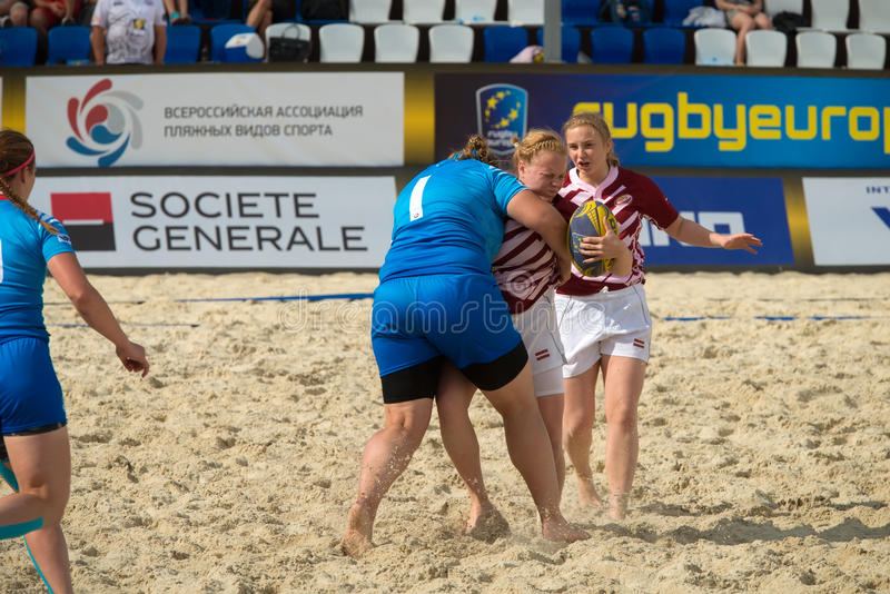Iron Vise. MOSCOW, RUSSIA - JULY 22-23, 2017: Rugby players in action at the on European Beach Fives Rugby Championship 2017 in the match Russia blue vs Latvia royalty free stock images