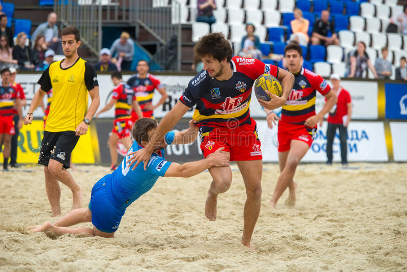 Ran away. MOSCOW, RUSSIA - JULY 22-23, 2017: Rugby players in action at the on European Beach Fives Rugby Championship 2017 in the match Russia blue vs Spain at stock photo