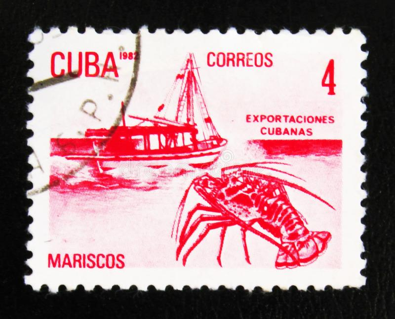 MOSCOW, RUSSIA - JULY 15, 2017: A stamp printed in Cuba shows a. Boat and a lobster (Mariscos), the series Exports, circa 1982 royalty free stock image