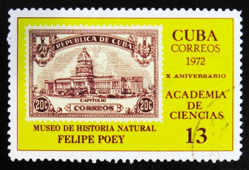 MOSCOW, RUSSIA - JULY 15, 2017: A stamp printed in Cuba shows Bu. Ilding of Museum of natural history, Felipe Poey, Academy of Sciences, 10th Anniv., circa 1972 stock photos