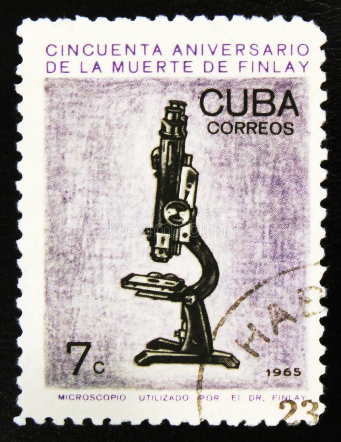 MOSCOW, RUSSIA - JULY 15, 2017: A stamp printed in Cuba shows mi. Croscope, 50th Anniversary of the Death of Carlos J. Finlay, Malaria Researcher, circa 1965 stock image