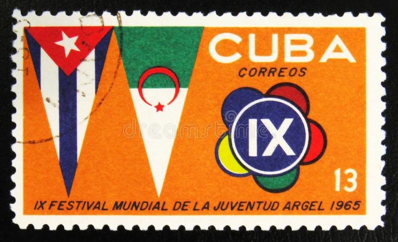 MOSCOW, RUSSIA - JULY 15, 2017: A stamp printed in Cuba shows pe. Nnants, 9th festival, circa 1965 stock image