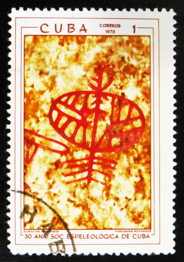 MOSCOW, RUSSIA - JULY 15, 2017: A stamp printed in Cuba shows pr. Ehistoric rock paintings, the series The 30th Anniversary of The Cuban Speleological Society stock photos