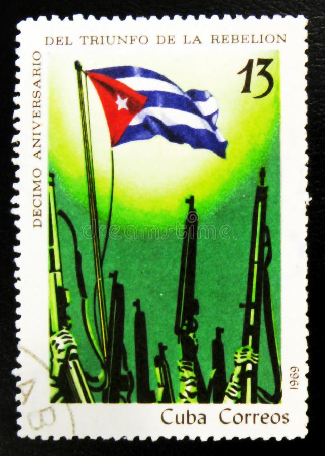 MOSCOW, RUSSIA - JULY 15, 2017: A stamp printed in Cuba shows We. Apons rise up, celebrating the 10th anniversary of the triumph of the rebellion, circa 1969 stock photos