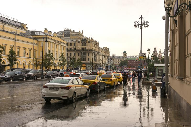 Moscow, Russia, July 17, 2019. Summer rain in Moscow, people under umbrellas walking down the street stock images