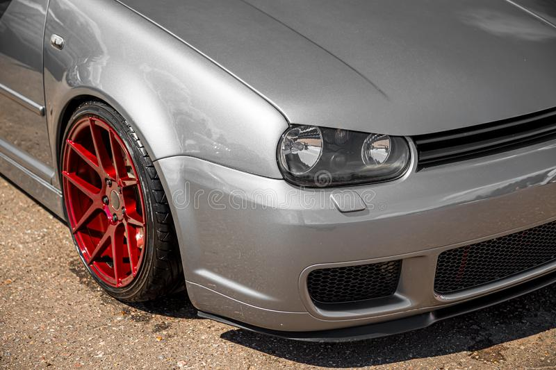 Moscow, Russia - July 19, 2019: Tuned low sport hatchback with red Candy colored alloy wheels. Volkswagen Golf mk 4 is on the. Street. Stanced lowrider with royalty free stock images