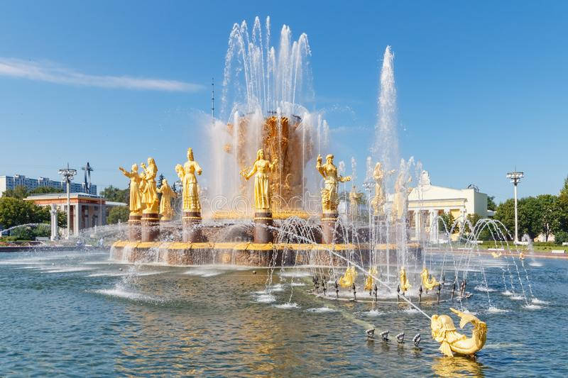 Moscow, Russia - July 22, 2019: View of water surface and golden figures of Friendship of Peoples fountain in VDNH park in Moscow stock photos