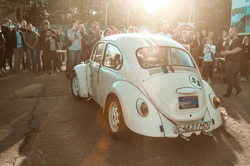 Moscow, Russia - July 06, 2019: Volkswagen beetle, beige. The restored retro car in the parking lot gathered a large crowd of stock photo