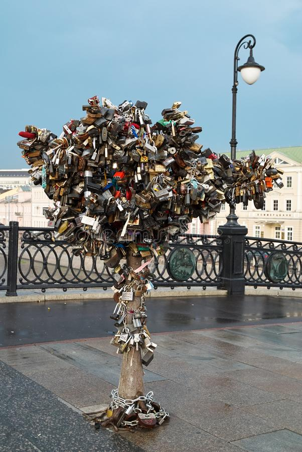 Moscow, Russia - July 17, 2008: Wedding locks on a metal tree on Luzhkov bridge in Moscow royalty free stock photo