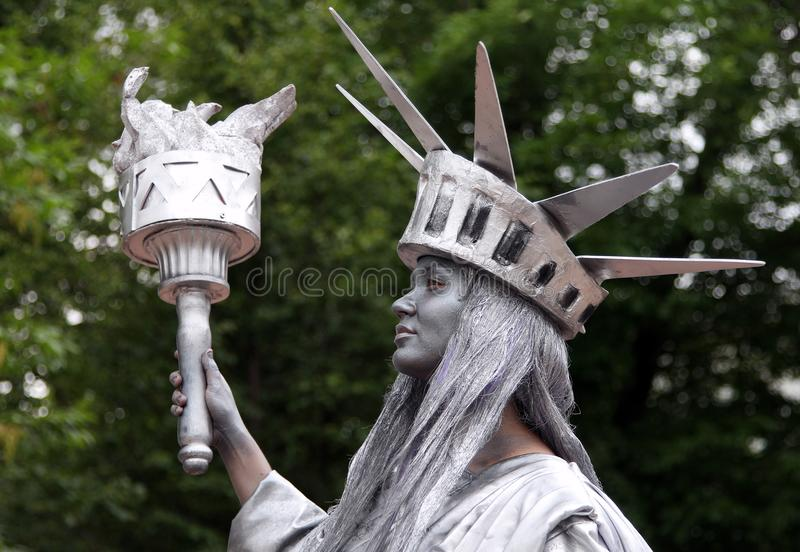 Living Statue of Liberty. MOSCOW, RUSSIA - JUN 16, 2012: Living Statue of Liberty at the annual festival of the famous russian travel magazine `Vokrug Sveta royalty free stock image