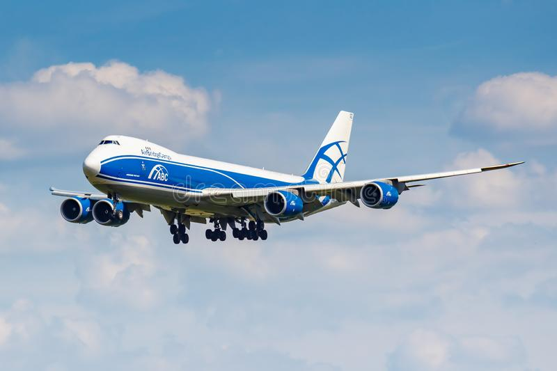 Moscow, Russia - June 21, 2019: Aircraft Boeing 747-8HVF VQ-BGZ of AirBridgeCargo airline landing at Domodedovo international. Airport in Moscow on a cloudy royalty free stock images