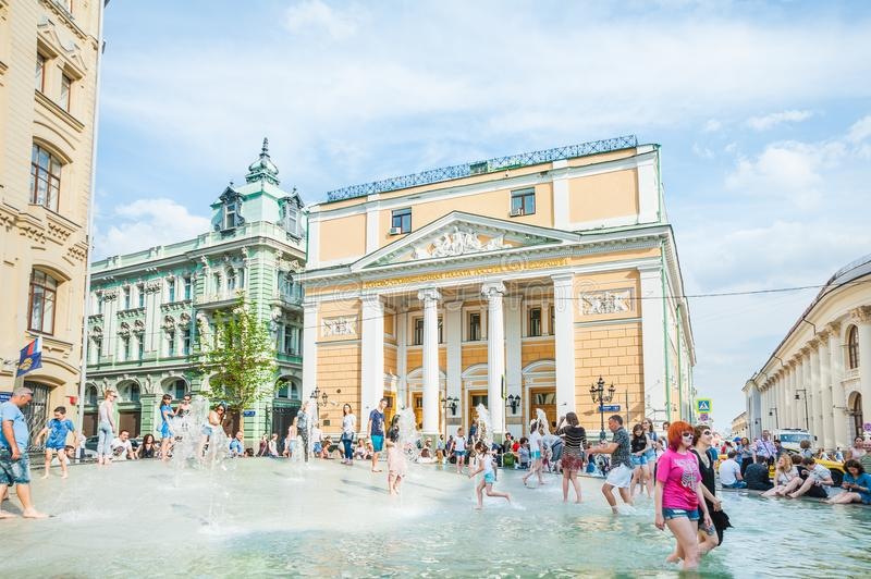 Birzhevaya square. The Chamber of Commerce and Industry of the Russian Federation. People splash in the fountain in hot weather. MOSCOW, RUSSIA - June 29, 2018 royalty free stock photos