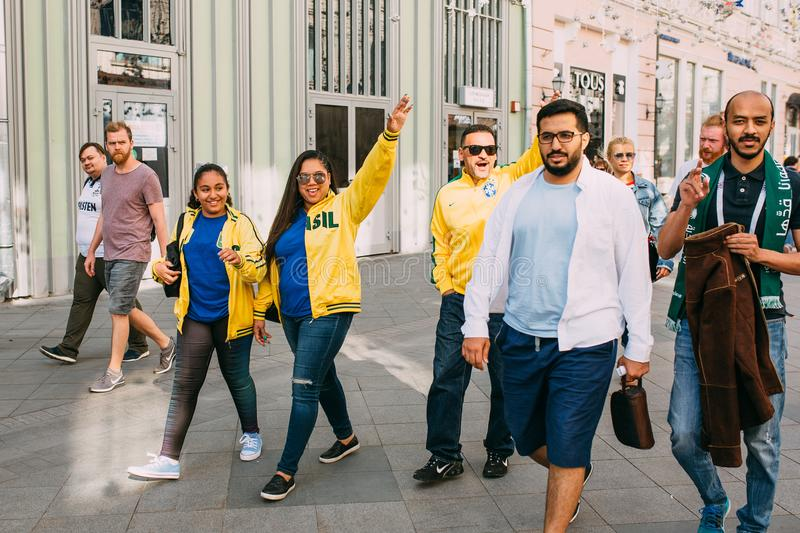 MOSCOW, RUSSIA - JUNE 2018: Brazilian fans are walking around the historic center of Moscow during the World Cup stock photography