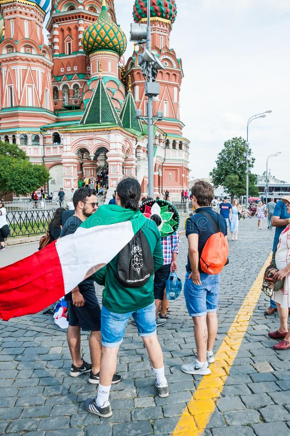 The 2018 FIFA World Cup. Mexican fans with Mexico flag on Red square. MOSCOW, RUSSIA - June 29, 2018: The 2018 FIFA World Cup. Mexican fans with Mexico flag on royalty free stock image