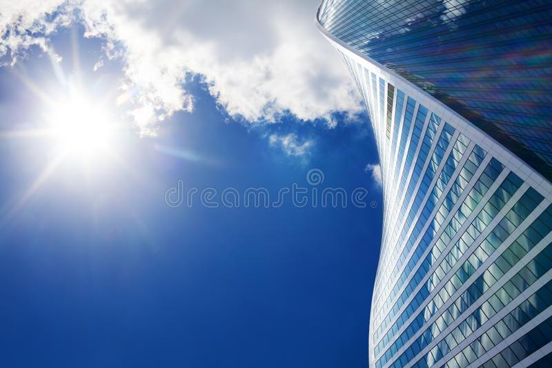 Moscow city International Business Center, spiral shape wall of skyscraper the Evolution Tower, blue sky, bright sun background stock images