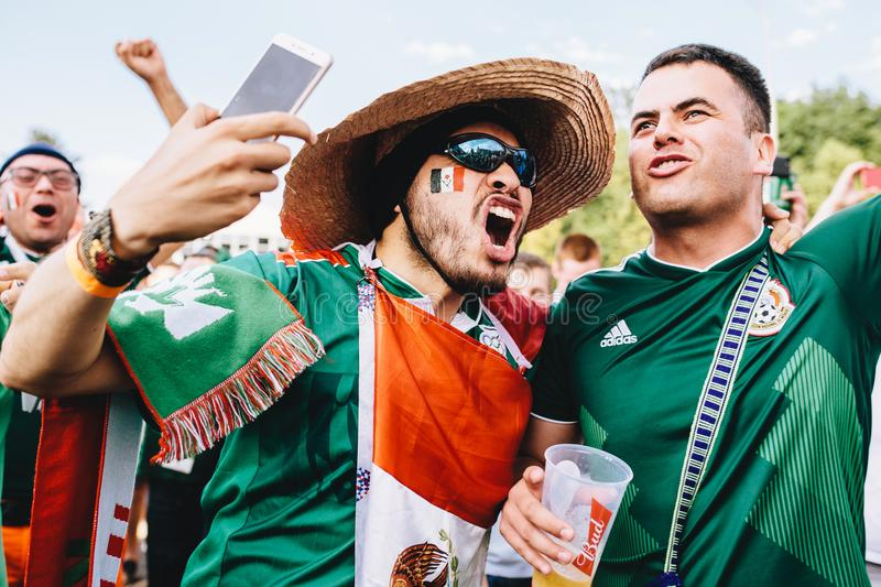 MOSCOW, RUSSIA - JUNE 2018: Mexican fans in sombrero and with the flag rejoice at the victory of their team at the World Cup FIFA. MOSCOW, RUSSIA - JUNE 2018 stock photos
