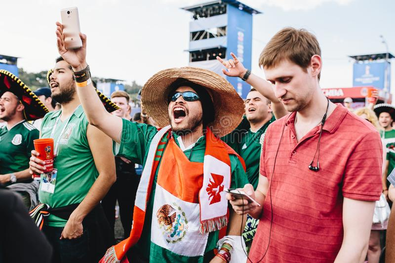 MOSCOW, RUSSIA - JUNE 2018: Mexican fans in sombrero and with the flag rejoice at the victory of their team at the World Cup FIFA. MOSCOW, RUSSIA - JUNE 2018 royalty free stock photos