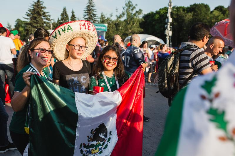 MOSCOW, RUSSIA - JUNE 2018: Mexican girls in sombrero are photographed with the national flag during the World Cup FIFA. MOSCOW, RUSSIA - JUNE 2018 Mexican girls stock photography