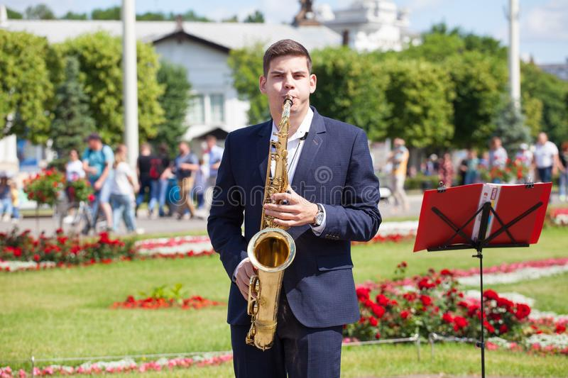 New Life Brass band, wind musical instrument player, orchestra performs music concert, handsome musician man plays on saxophone stock photography