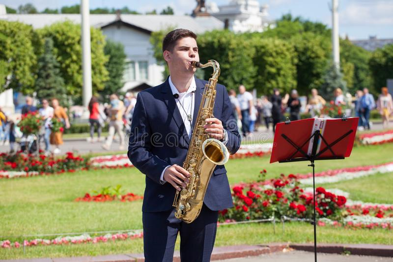 New Life Brass band, wind musical instrument player, orchestra performs music concert, handsome musician man plays on saxophone royalty free stock images