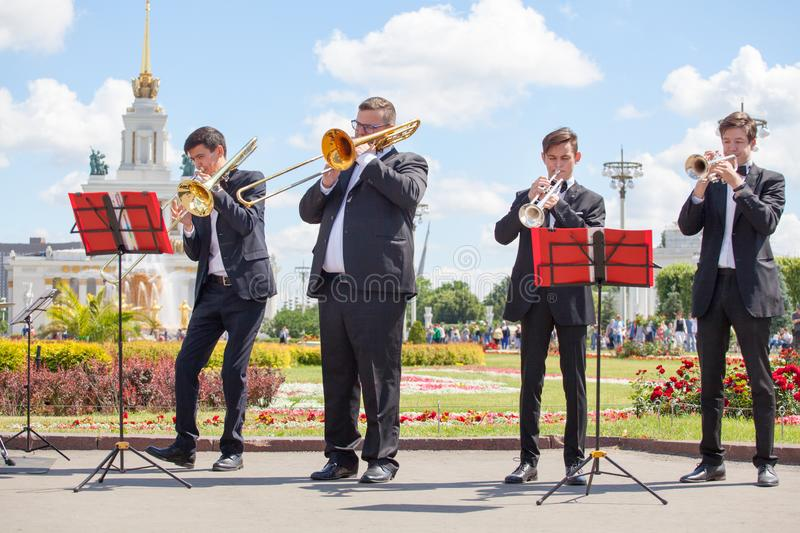 New Life Brass band, wind musical instrument players, orchestra performs music closeup, four musician men play trumpets, trombones royalty free stock photography