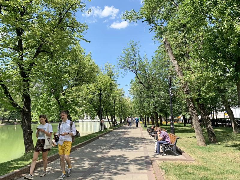 Moscow, Russia, June, 20, 2019. People walking along Chistoprudny Boulevard in sunny June day stock images