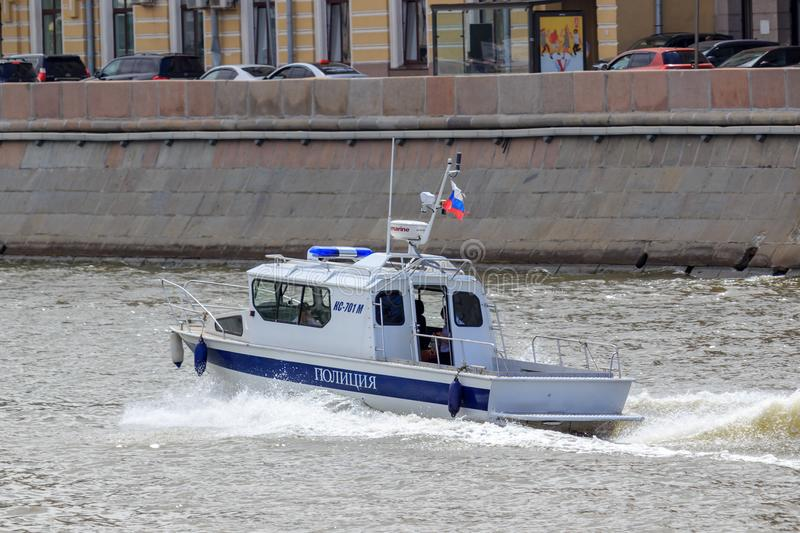 Moscow, Russia - June 21, 2018: Police boat rushing along water surface on a background of Moskva river embankment on a sunny summ. Er day royalty free stock photos