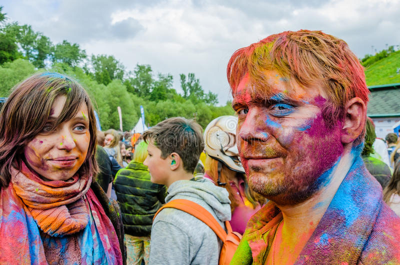 Moscow, Russia - June 3, 2017: Portrait of man and woman with faces covered with paints after Holi festival-expression stock photography