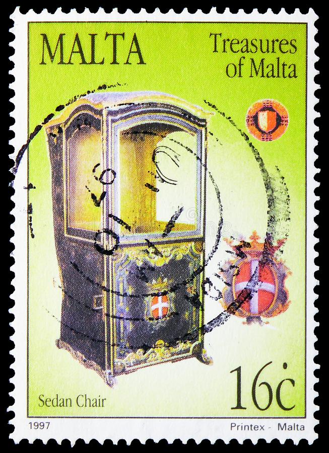 Chair from Cathedral Museum, Mdina, Treasures of Malta, Sedan Chairs serie, circa 1997. MOSCOW, RUSSIA - JUNE 19, 2019: Postage stamp printed in Malta shows royalty free stock photography