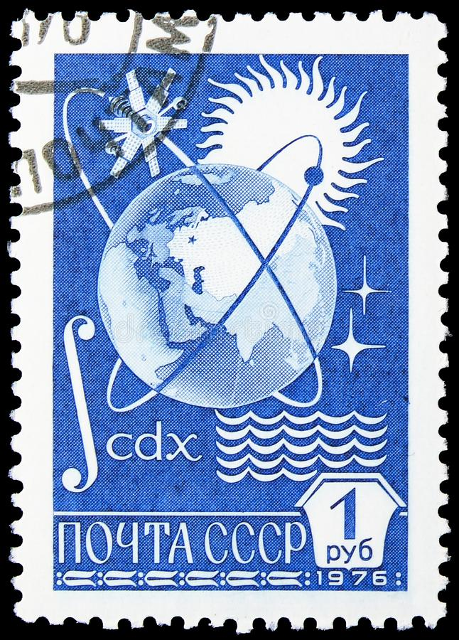 Globe and sputnic on orbit, from 12th Definitive Issue serie, circa 1976. MOSCOW, RUSSIA - JUNE 19, 2019: Postage stamp printed in Soviet Union USSR shows Globe stock photos