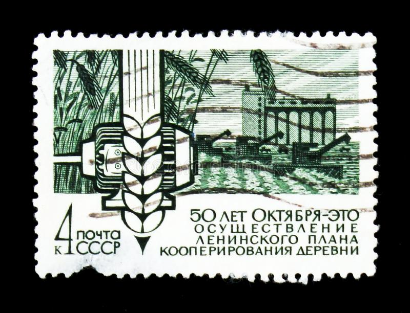 Ear of wheat and grain silo, 50th Years of Socialist serie, circa 1967. MOSCOW, RUSSIA - JUNE 26, 2017: Rare stamp printed in USSR Russia shows farm, motor stock image
