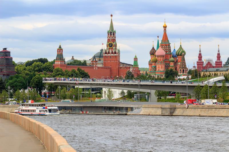 Moscow, Russia - June 21, 2018: Soaring bridge in Zaryadye Park on a background of Moscow Kremlin and Moskva river embankments in stock photography