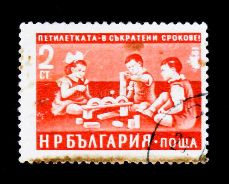 Children playing, Five-Year Plan in Shorter Time Limits serie, circa 1960. MOSCOW, RUSSIA - JUNE 26, 2017: A stamp printed in Bulgaria shows Children playing stock images