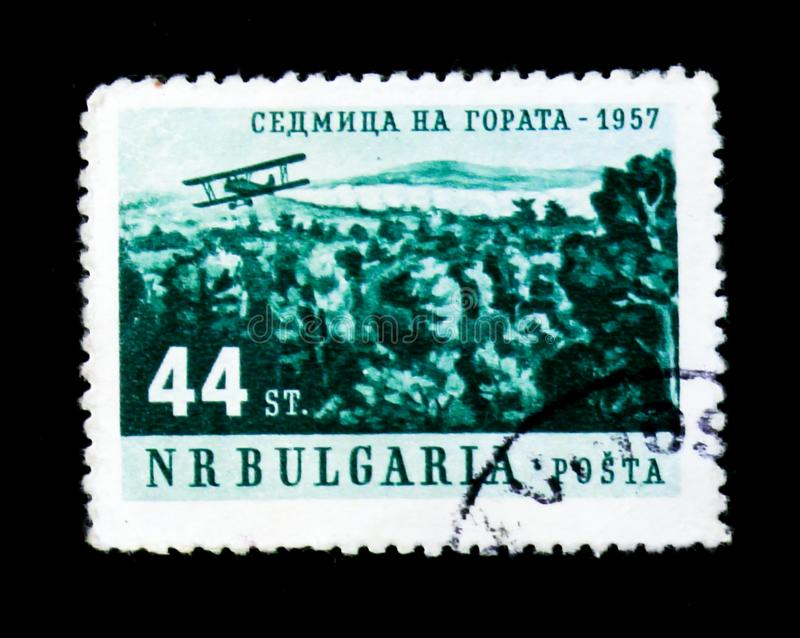 Plane and forests, a week in forest serie, circa 1957. MOSCOW, RUSSIA - JUNE 26, 2017: A stamp printed in Bulgaria shows a plane and forests, a week in forest stock photos