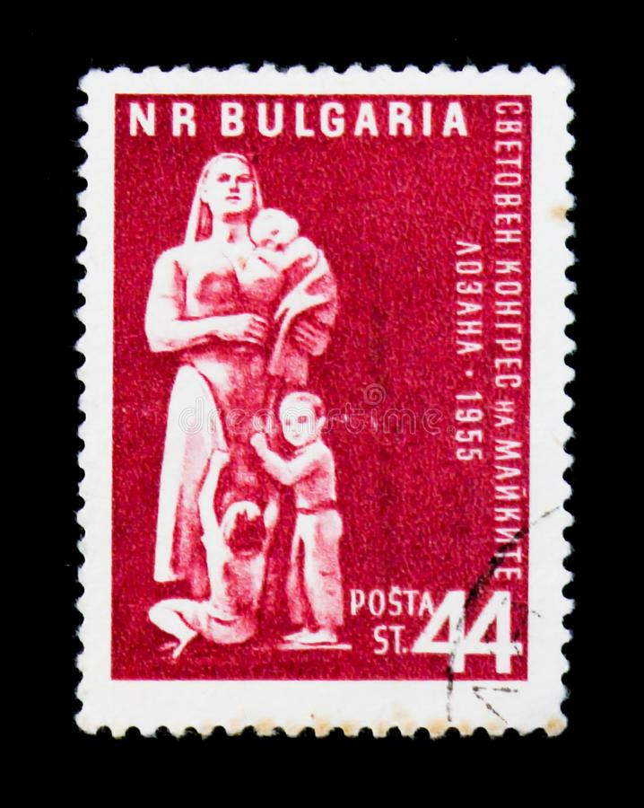 Woman with children, Congress in Lausanne, circa 1955. MOSCOW, RUSSIA - JUNE 26, 2017: A stamp printed in Bulgaria shows woman with children, Congress in stock photo