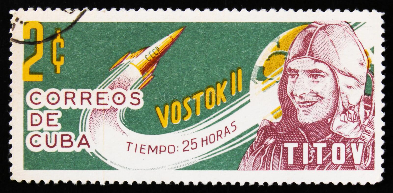 Cuba postage stamp shows portrait of Titov, Soviet cosmonaut, with rocket Vostok 2, circa 1963 royalty free stock photos