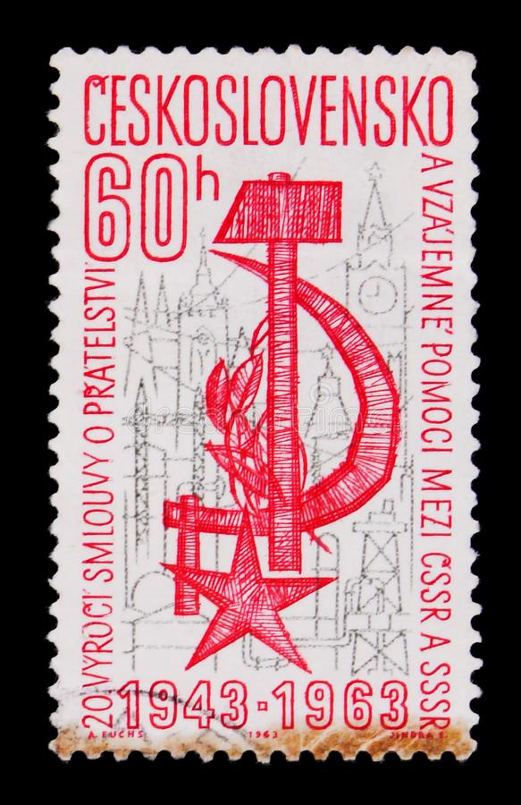MOSCOW, RUSSIA - JUNE 20, 2017: A stamp printed in Czechoslovakia shows star, hammer, sickle and city, 20th anniversary Russia Cz. Ech treaty, circa 1963 stock photo
