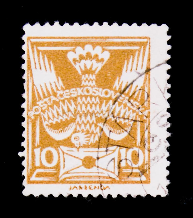 MOSCOW, RUSSIA - JUNE 20, 2017: A stamp printed in Czechoslovakia shows carrier pigeon with letter, circa 1920 royalty free stock photos
