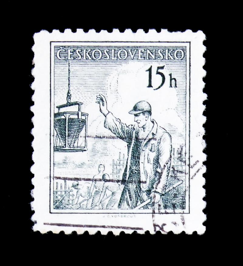 MOSCOW, RUSSIA - JUNE 20, 2017: A stamp printed in Czechoslovaki. A shows Construction worker, circa 1954 royalty free stock photos