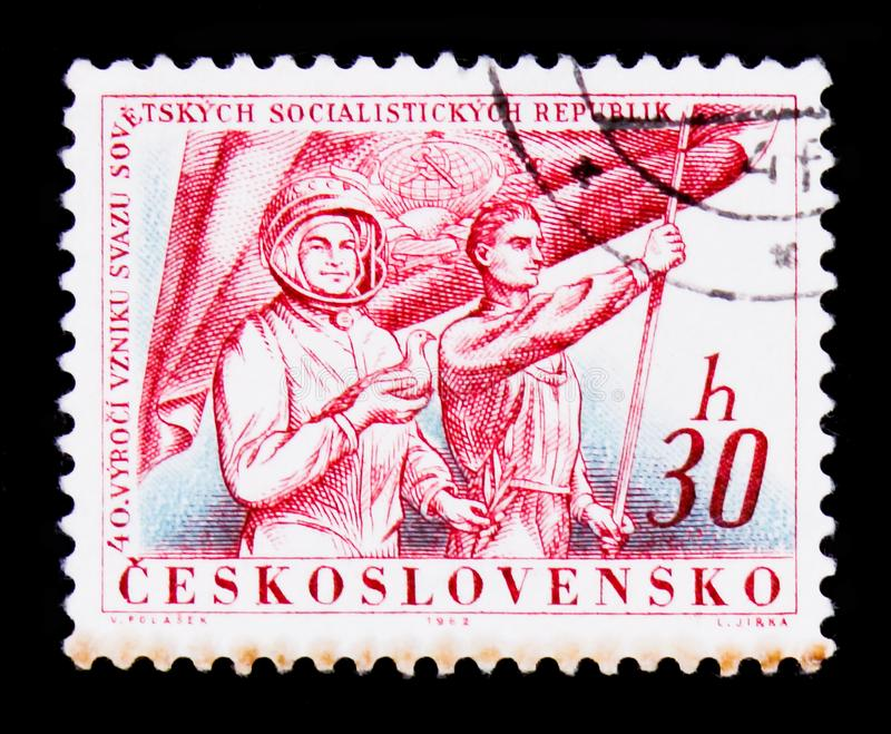 MOSCOW, RUSSIA - JUNE 20, 2017: A stamp printed in Czechoslovakia shows cosmonaut and worker with flag, devoted to. 40 anniv of fouded Soviet socialist stock photos